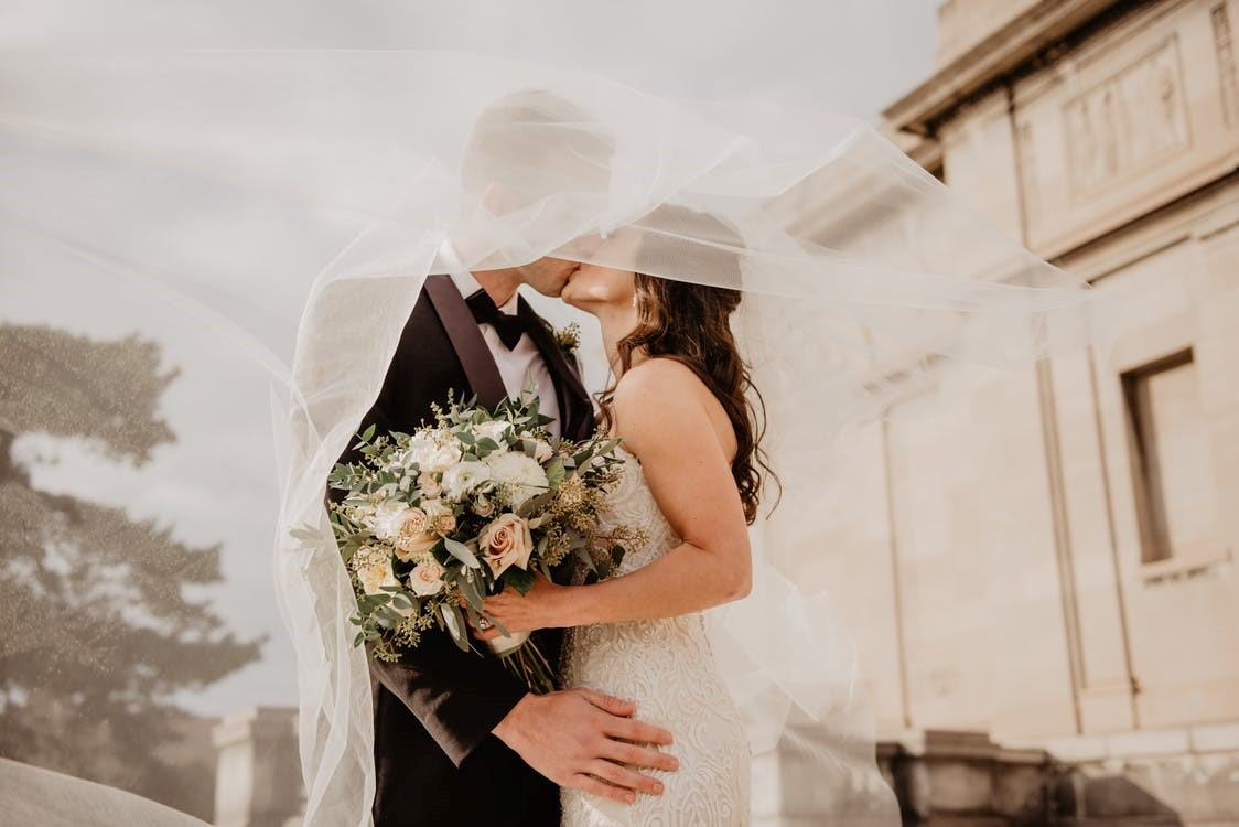 A bride and groom kissing on their wedding day